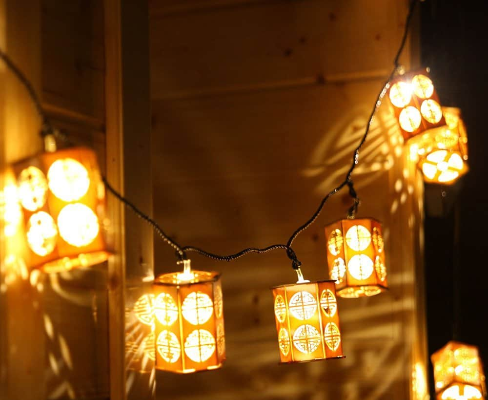 wooden lantern style string lights
