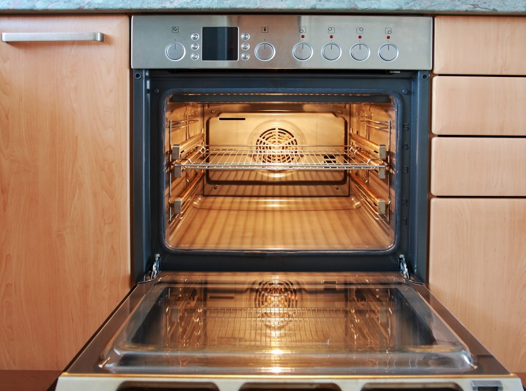 Empty oven with turned on light